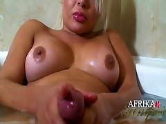 Voluptuous Blonde soaping up her Cock in the Shower