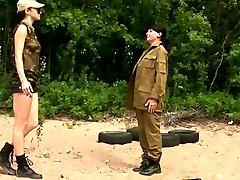 Tall female sergeant trains a petite army babe