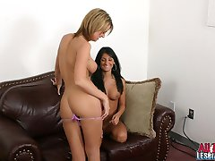 Sunbathing lesbians Jessie and Persia sharing a giant strapon