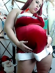 Pregnant horny pornstar Georgia Peach strips out of her little slutty Christmas outfit