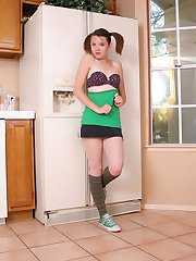 Cute 18 year old Kir gets topless as she strips out of her star covered bra in the kitchen
