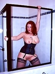 Naughty curvy red head with big silver vibrator