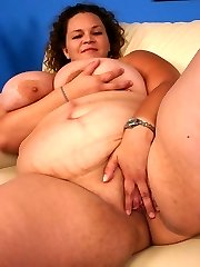 Monstrous bbw Mona Orbs showing off her epic blowjob and taking a black beef whistle in her chubby pussy slit