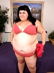 Cute teen BBW Ursula acting sexy and slowly stripping off her clothes for the camera