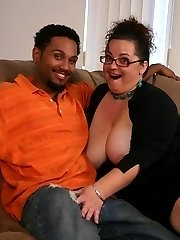Sexy mature BBW Shianna gives off an excellent head and straddles on top to fuck a black dick
