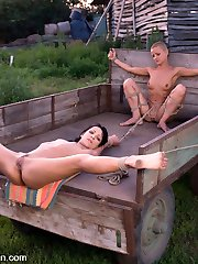 Sabrina works at a well in an open field on a scorching summer day. Her master, Steve Holmes,...