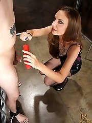 With his cock and balls tired to a bondage bed, Mistress Mona pours hot wax all over them. She...