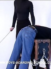 Naughty lad bent over the trestle with his pants down - hard caning from cruel blonde bitch