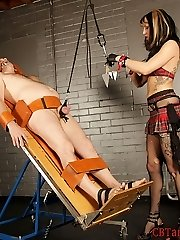 Femdom Dahlia straps her victim down to a medical table and shoves a dental gag in his jaws.  With him completely defenseless, she focuses on what to do to his cock and plums.  Dahlia affixes a parachute to his balls and strings them up.  Dahlia slowly adds more and more lead weights to pull on her slave's balls.  Inbetween adding more weight, Dahlia strikes and tortures him for her enjoyment.