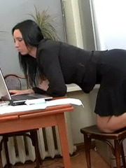Annas slave is lying at her feet and shes trying to finish her work with the computer