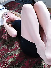 Smashing looking blondie fondles her lovely feet with her pantyhosed hand