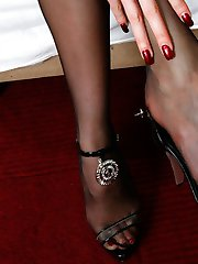 Seductive gal in control top pantyhose presses buttons with her lovely feet