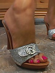 Sexy blonde sucks her painted toes before foot stroking a cock