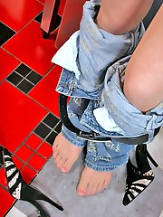 Nasty gal winding round her pantyhose clad legs while going wild in kitchen