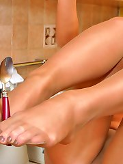 Lascivious blonde gal in shiny pantyhose getting horny right in the kitchen