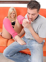 Barefoot maniac gets a well deserved foot job from this blonde