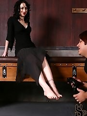 Mina complains about her footslave's behavior and then has him shove the heel of her high heel down his throat. He gags as he deep throats her shoe's heel. She allows him to take off her shoes and she then tries to smother her foot slave's face with the soles of her feet. Mina has him put her entire foot into his mouth, sucking her toes deep into his mouth. He massages her feet a little more before he is dismissed.