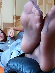 Hot business damsel puts off her pantyhose aching for some rest for her feet
