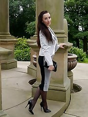 Super-sexy dark haired Sophia gets out the office to walk and tease outdoors in nylon stocking and high stiletto heels