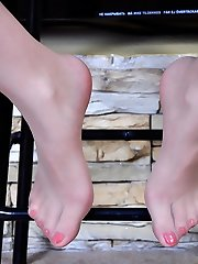 Pervy damsel licks her high high-heeled slippers and shows off crimson painted nylon clad toes