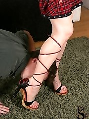 Rosy comes home to her boyfriend and asks him if he is interested in becoming her sole slave. Sans a doubt, he of course says yes, and instantly get down and starts worshiping her beautiful feet. He idolizes her feet and gams through her super sexy high high-heeled shoes, that wrap up around her calves. Pink then suggests he take off her high-heeled slippers, and allows him to lose himself in her feet.