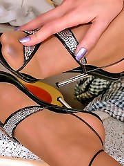 Redhead gal getting wild while pleasing her nyloned pink with playful hands