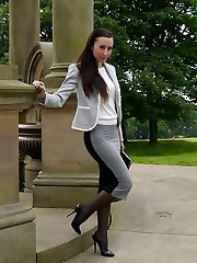 Gorgeous dark-haired Sophia gets out the office to walk and taunt outdoors in nylon stocking and high stiletto heels