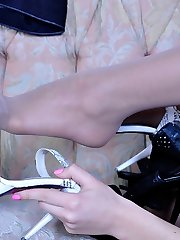 Pretty doll teases with her nylon clad feet trying on various heeled shoes