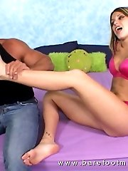Sexy blonde gives a hot foot job before getting rammed with a stiff dick from behind