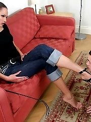 Stunning beauty queen smoking and putting her steel heels into slaves mouth.