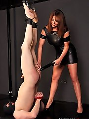 Sexy Mistress Carly turns her submissive upside down and rams his ass with a big dildo.