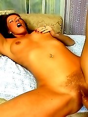 Brunette milf gobbles a fat rod then spreads her hairy snatch to be intensively fucked