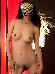Exotic butterfly babe masking her pretty face while baring her hair-cushioned cunt!