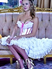 Eye-catching doll in a showy dress with pink satin top stockings uses a toy