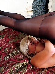 Dazzling blondie licking her ripe peaches and fondling her pantyhosed pussy