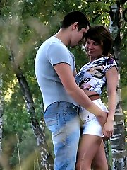 Sexy babe in tan tights flashing her downskirt outdoors while getting down