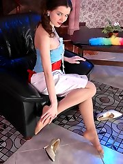 Smashing looking gal giving a glimpse of her lovely feet in silky pantyhose