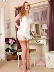 Lovely red head Alexa prepares herself with feminine finery for some sexy passion, in her...
