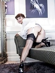 Too cute for office work, Rosie looks the part. No panties and a flash of black nylon stocking...