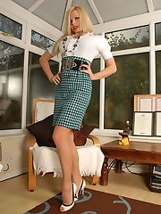 In a sexy hounds tooth pencil skirt Michelle shows her sheer nylon panties, and her eye catching...