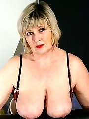 Big breasted mama playing with her wet pussy