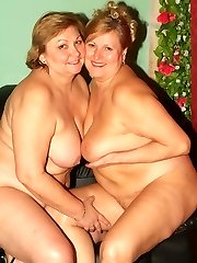Mature girl-girl plumpers Anna and Yolanda engage in lesbian fuckfest games and make their gigantic twats humid