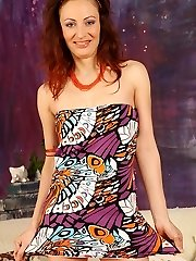 Redhead Cougar Misa looking sexy in orange heels as she plays with her honeypot.