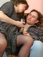 Salacious mom in silky tights fervently rubbing against pantyhose clad cock