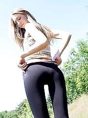 Women in skin tight jeans under sun