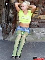 Blonde girl in green hosepipe up skirt