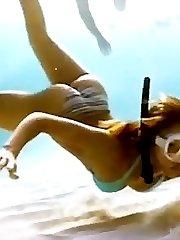 Alba dives in bikini & dances in fishnets