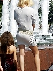 Hot upskirt girls have fun by fountain