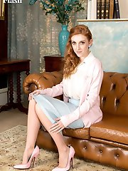 Redhead Alexa strips down to her retro lingerie, pink heels and sheer tan nylons.