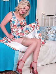Anna is feeling fresh, lovely in her floral frock and stiletto sandals. Underneath she's in rare vintage bra and a deep full garter belt, real 50's glamour!